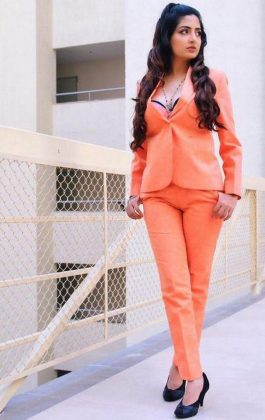 Poonam Kaur Roasting in Orange Stills